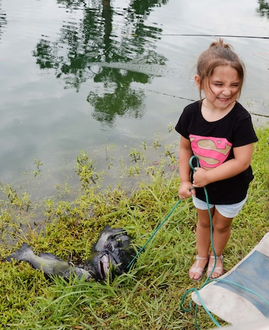 """Three-year old Kinsley Snider catches three """"monster"""" fish at Marine Corps Logistics Base Albany's annual Buddy Fishing Tournament, June 3. Kinsley's 10.1 pound catfish, earned her a trophy for the largest fish in her age category. The event, which is held at the installation's Covella Pond, is opened to the communities' youngest anglers and their fishing buddies."""