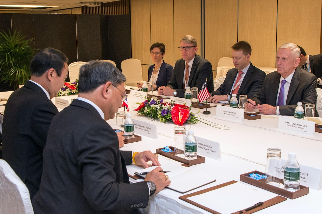 Defense Secretary Jim Mattis meets with Gen. Udomdej Sitabutr, Thailand's deputy defence minister, during the Shangri-La Dialogue in Singapore, June 3, 2017. DoD photo by Air Force Staff Sgt. Jette Carr