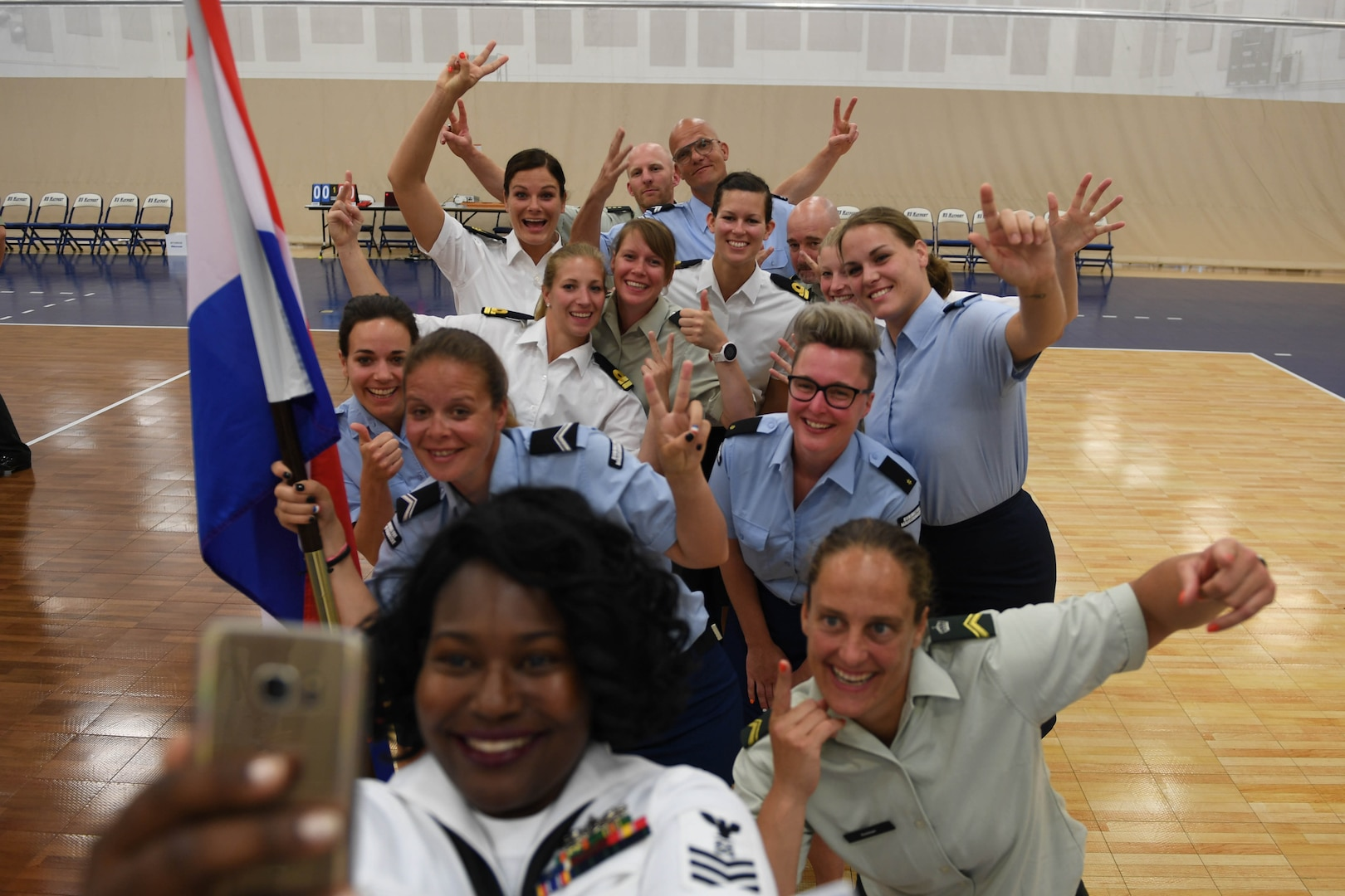 170603-N-UK306-192 JACKSONVILLE, Fla. (June 3, 2017)  Compeititors take part in the opening ceremony of the 18th Conseil International du Sport Militaire (CISM) World Military Women's Volleyball Championship at Naval Station Mayport.  Teams from the United States, Canada, China, Germany and The Netherlands will compete June 4-9, while promoting peace activities and solidarity among athletes. (U.S. Navy photo by Mass Communication Specialist 2nd Class Timothy Schumaker/Released)