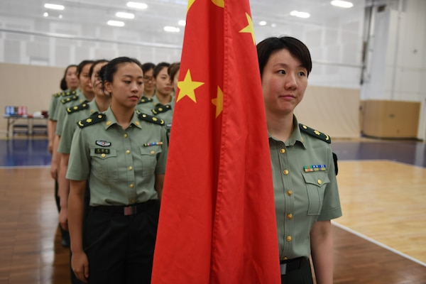 170603-N-UK306-031 JACKSONVILLE, Fla. (June 3, 2017)  Compeititors from China take part in the opening ceremony of the 18th Conseil International du Sport Militaire (CISM) World Military Women's Volleyball Championship at Naval Station Mayport.  Teams from the United States, Canada, China, Germany and The Netherlands will compete June 4--9, while promoting peace activities and solidarity among athletes. (U.S. Navy photo by Mass Communication Specialist 2nd Class Timothy Schumaker/Released)