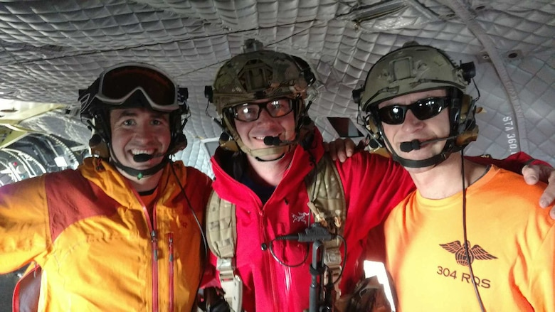 From left to right: Staff Sgts. Kevin and Ross, 304th Rescue Squadron pararescuemen, and Capt. Zachery, 304th RQS  combat rescue officer, pose on board a U.S. Army Reserve CH-47 Chinook rescue helicopter after rescuing a stranded climber on Mount Rainier, Washington. The 304th RQS is a geographically separated unit from the 920th Rescue Wing at Patrick Air Force Base, Florida. (U.S. Air Force courtesy photo)