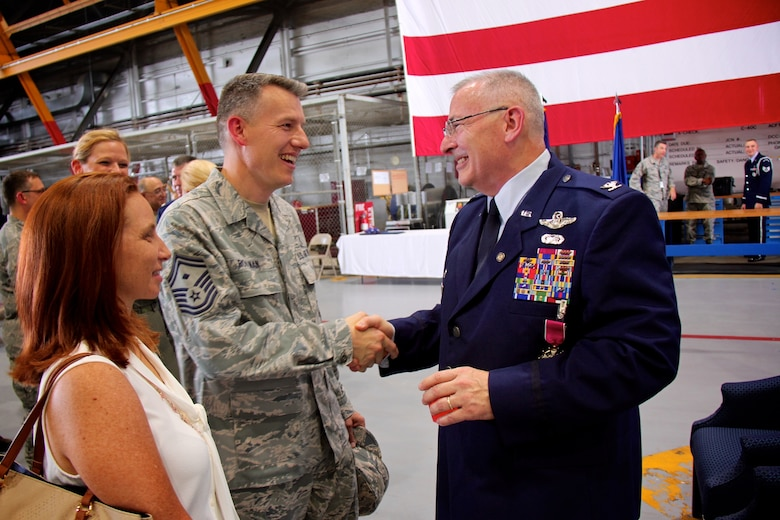 """932nd Airlift Wing First Sergeant, Senior Master Sgt. Brian Rohlman, congratulates his commander, Col. Jonathan Philebaum, as he retires on June 3, 2017, at Scott Air Force Base, Illinois.  Friends and family from around the nation came to the 932nd Airlift Wing """"Gateway Wing"""", to see the retiring commander's last day, and to thank him for more than 31 years of faithful service to the United States Air Force and Air Force Reserve Command.  (U.S. Air Force photo by Lt. Col. Stan Paregien)"""