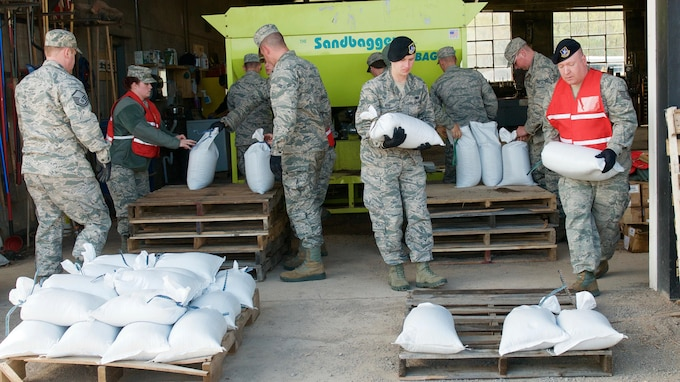 WILLIAMSON, NY - Members of the New York Air National Guard's 174th Attack Wing  provide support to the residents of Wayne County and neighboring communities in response to the flooding crisis on Lake Ontario. Airmen filled over 44 thousand sandbags to reinforce banks and reduce water flow.