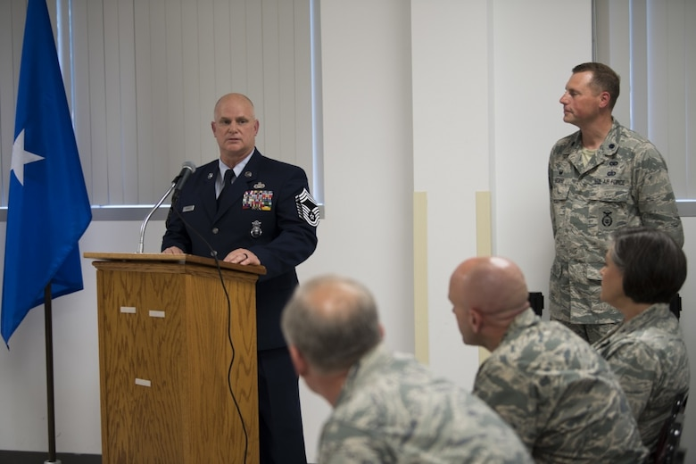 Chief Master Sgt. P. Wayne Hughes speaks to the crowd of Security Forces personnel at his promotion ceremony held June 3, 2017 at McLaughlin Air National Guard Base, Charleston, W.Va. Hughes is a 27-year veteran of Security Forces who will assume the role of chief enlisted manager with this promotion. (U.S. Air National Guard photo by Capt. Holli Nelson)