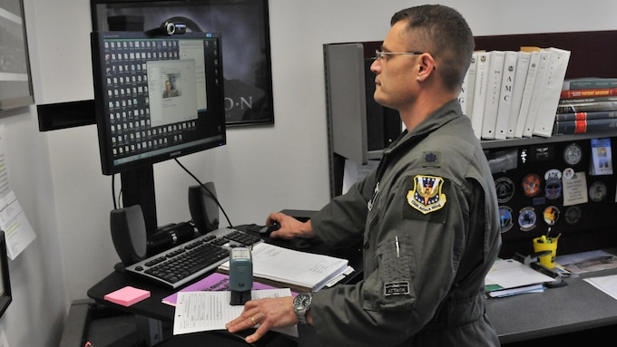 Lt. Col. Michael Kenney, Chief of Aerospace Medicine for the 174th Medical Group, demonstrates telemedicine capabilities of the Air National Guard on April 2, 2017 at Hancock Field Air National Guard base.