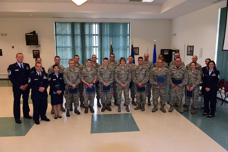 Airmen recognized at the first Non-Commissioned Officer induction ceremony, held at Stratton Air National Guard Base, pose for a group photo, Scotia, New York on June 3, 2017.  The induction ceremony recognizes Airmen who were promoted to staff sergeant between May 1, 2016 and May 15, 2017. More than 30 Airmen were recognized during the ceremony. (U.S. Air National Guard photo by Staff Sgt. Benjamin German/Released)
