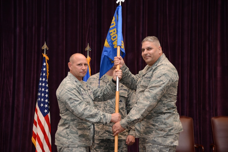 Col. Kurt Matthews (right), 920th Rescue Wing commander, hands the 920th Operations Group guidon to Col. Michael Loforti, during an assumption of command ceremony, June 3, 2017 at Patrick Air Force Base, Florida. (U.S. Air Force photo/Staff Sgt. Jared Trimarchi)