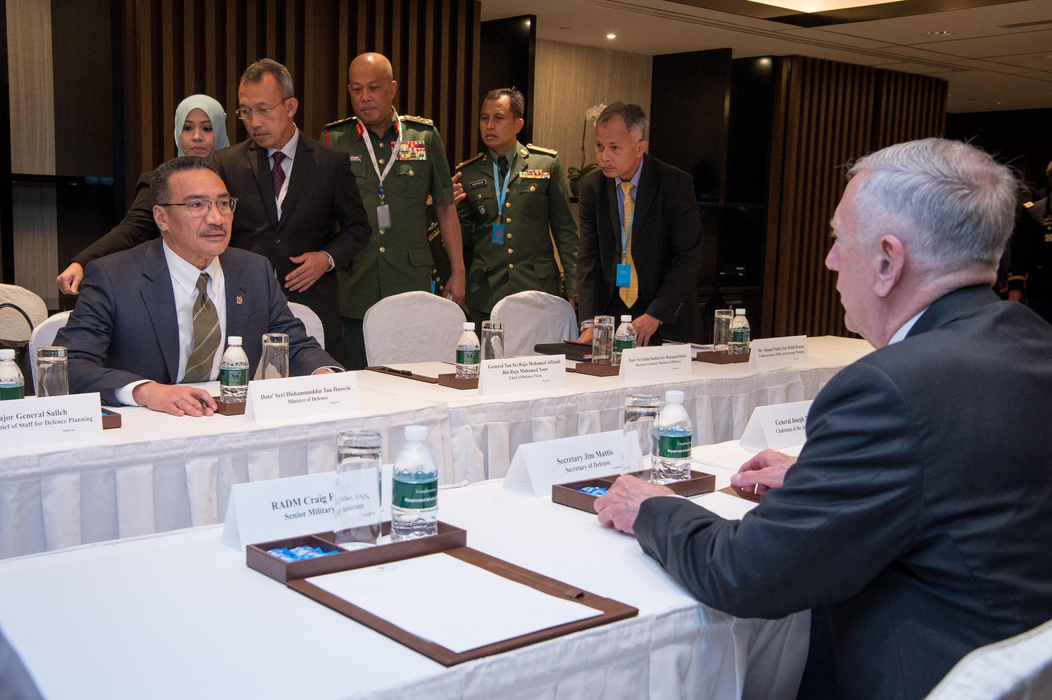 Defense Secretary Jim Mattis, right, meets with Malaysian Defense Minister Hishammuddin Tun Hussein.