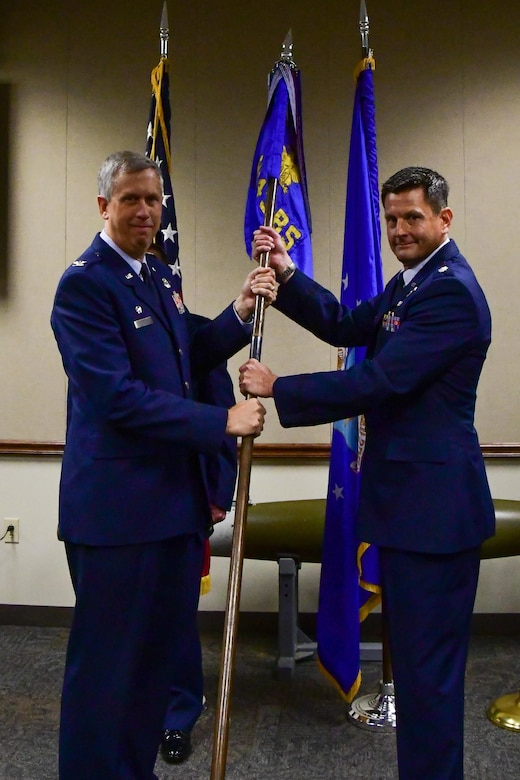 U.S. Air Force Col. Robert N. Burgess, 307th Operations Group commander, presents the guidon of the 343rd Bomb Squadron to Lt. Col. John P. Booker during a change of command ceremony at Barksdale Air Force Base, La., June 3, 2017. Booker is assuming command of the only Air Force Reserve nuclear certified bomb squadron. (U.S. Air Force photo by Master Sgt. Dachelle Melville/Released)