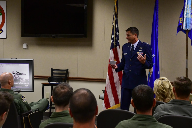 U.S. Air Force Lt. Col. John P. Booker speaks as the commander of the 343rd Bomb Squadron for the first time during a change of command ceremony on Barksdale Air Force Base, La. June 3, 2017. Booker is a command pilot with over 4,700 flight hours. (U.S. Air Force photo by Master Sgt. Dachelle Melville/Released)