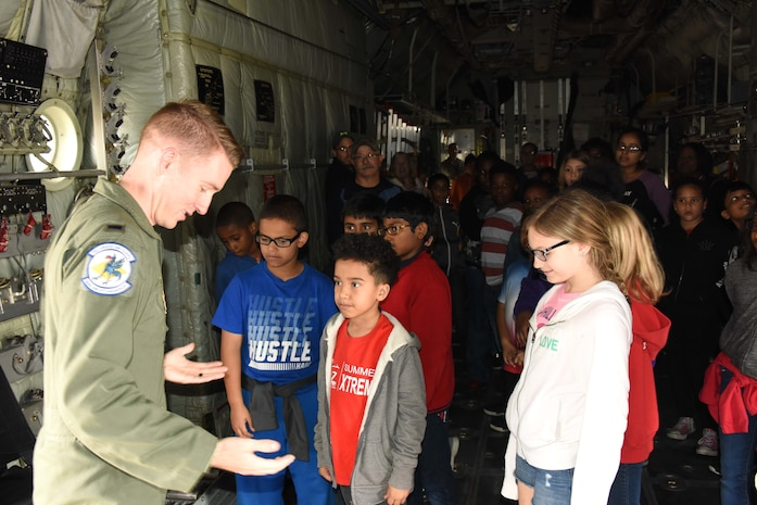 NEW CASTLE AIR NATIONAL GUARD BASE, Del.- Thurgood Marshall Elementary Students had the opportunity to tour a Delaware Air National Guard C-130H aircraft and meet with members of the 166th Operations Group, students also asked questioned about the different uniforms worn by aircrew members to a pilot during the visit on May, 25, 2017. (U.S. Air National Guard photo by Tech. Sgt. Gwendolyn Blakley/Released).