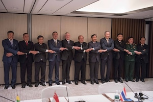 Defense Secretary Jim Mattis and defense ministers from the Association of South East Asian Nations stand together during the Shangri-La Dialogue in Singapore.