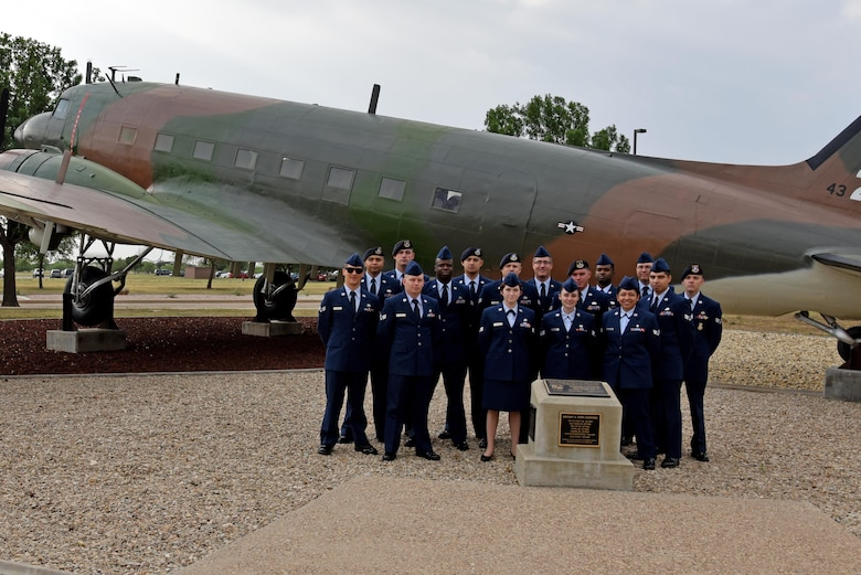 Airman leadership school class 17-D stands before a static plane display on Goodfellow Air Force Base, Texas, May, 23, 2017. ALS is a 6-week course designed to prepare senior airmen to assume supervisory duties, offering instruction in the practice of leadership and followership, written and oral communicative skills, and the profession of arms. (U.S. Air Force photo by Staff Sgt. Joshua Edwards/Released)