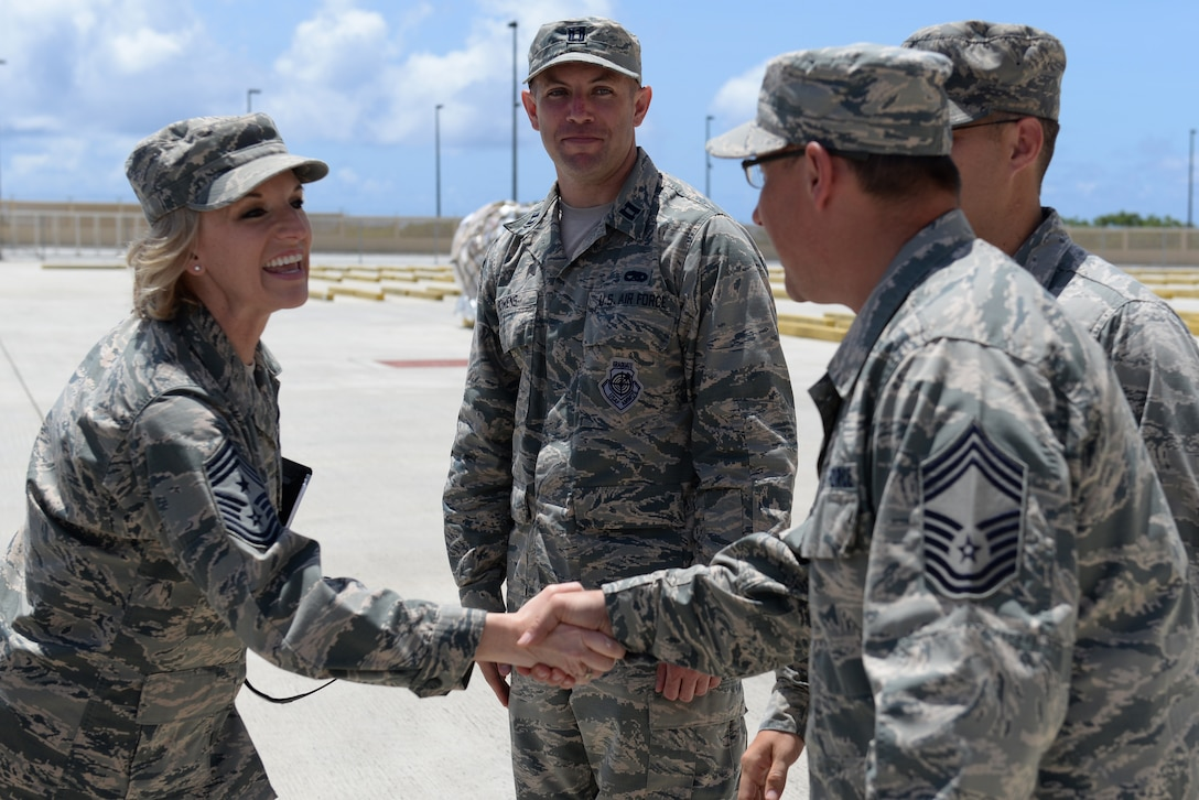 U.S. Air Force Chief Master Sgt. Gay Veale, 11th Air Force command chief, talks to Chief Master Sgt. Danny Graves, 734th Air Mobility Squadron superintendent, June 1, 2017, at Andersen Air Force Base, Guam. Veale toured Andersen as part of a visit to get a firsthand look at Airmen in action across the Pacific and the 11th Air Force. (U.S. Air Force photo by Airman 1st Class Gerald R. Willis)