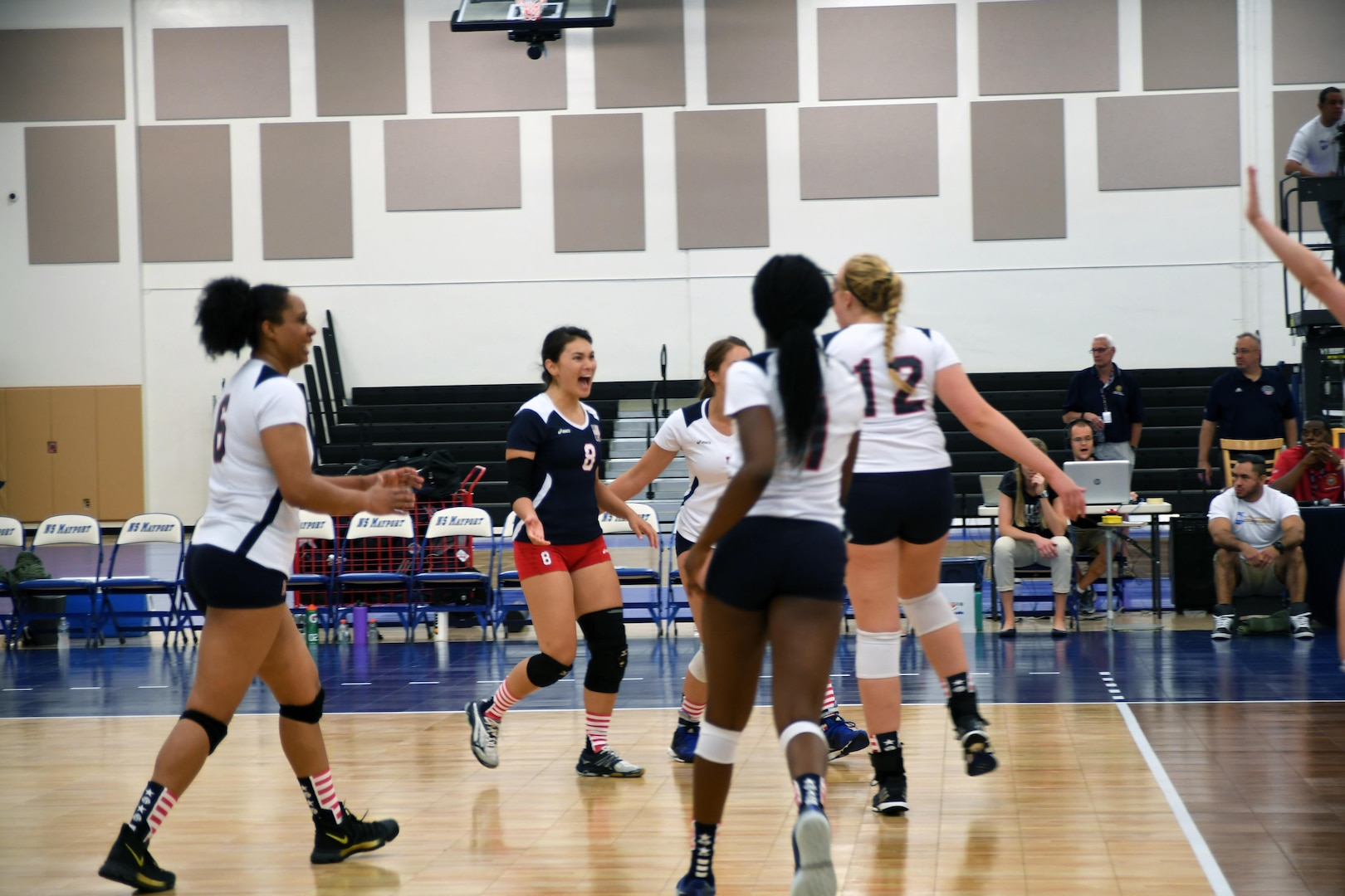 U.S. Armed Forces Women's Volleyball team celebrate a point against China in match 1 of the 18th Conseil International du Sport Militaire (CISM) World Women's Military Volleyball Championship at Naval Station Mayport, Florida on 4 June 2017. Mayport is hosting the CISM Championship from 2-11 June.  Finals are on 9 June.