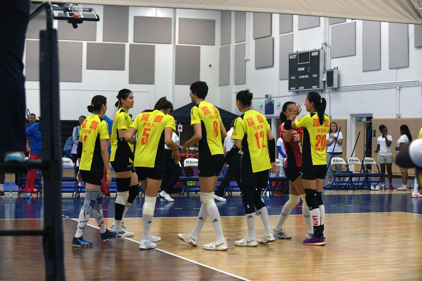 Chinese Women's Volleyball Team celebrates their victory over USA in match 1 of the 18th Conseil International du Sport Militaire (CISM) World Women's Military Volleyball Championship at Naval Station Mayport, Florida on 4 June 2017. Mayport is hosting the CISM Championship from 2-11 June.  Finals are on 9 June.