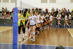 USA and China greet one another as they prepare for the opening match of the 18th Conseil International du Sport Militaire (CISM) World Women's Military Volleyball Championship at Naval Station Mayport, Florida on 4 June 2017. Mayport is hosting the CISM Championship from 2-11 June.  Finals are on 9 June.