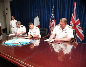 MANAMA, Bahrain (June 1, 2017) Vice Adm. Louis-Michel Guillaume, left, commander of French Submarine and Strategic Oceanic Forces, Vice Adm. Kevin M. Donegan, middle, commander of the U.S. Naval Forces Central Command, and Rear Adm. Robert K. Tarrant, commander Operations of the Royal Navy, sign an agreement to increase coordination for anti-submarine warfare activities between France, the U.S. and the United Kingdom. The agreement follows the signing of a trilateral cooperation agreement by Chief of Naval Operations Adm. John Richardson, the First Sea Lord of the United Kingdom Adm. Sir Philip Jones and French Chief of Naval Staff Adm. Christophe Prazuck in London on March 27. (U.S. Navy photo by Mass Communications Specialist 2nd Class Victoria Kinney/Released)
