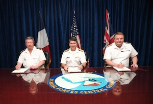 MANAMA, Bahrain (June 1, 2017) From left, Vice Adm. Louis-Michel Guillaume, commander of French Submarine and Strategic Oceanic Forces, Vice Adm. Kevin M. Donegan, commander of U.S. Naval Forces Central Command, and Rear Adm. Robert K. Tarrant, commander Operations, Royal Navy, sign an agreement designed to increase coordination for anti-submarine warfare activities between France, the United States and the United Kingdom. The agreement follows the signing of a trilateral cooperation agreement by Chief of Naval Operations Adm. John Richardson, the First Sea Lord of the United Kingdom Adm. Sir Philip Jones and French Chief of Naval Staff Adm. Christophe Prazuck in London on March 27. (U.S. Navy photo by Mass Communications Specialist 2nd Class Victoria Kinney)