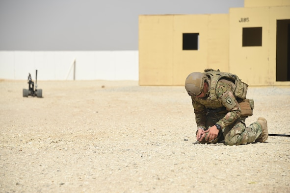 An Army explosive ordnance disposal technician, assigned to the 630th EOD Company, performs counter improvised explosive device techniques during a joint service EOD field training exercise at an undisclosed location in Southwest Asia, May 23, 2017. EOD teams from each of the four service branches, deployed to five different countries across the AOR, gathered for joint service EOD training, which allowed for the exchange of tactics, techniques and procedures between service branches. (U.S. Air Force photo/Tech. Sgt. Jonathan Hehnly)