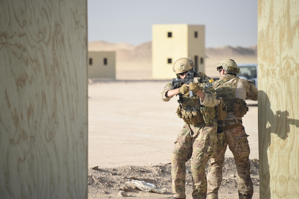 A pair of Air Force and Navy explosive ordnance disposal technicians work together to cover one another during a joint service EOD field training exercise at an undisclosed location in Southwest Asia, May 23, 2017. EOD teams from each of the four service branches, deployed to five different countries across the AOR, gathered for joint service EOD training, which allowed for the exchange of tactics, techniques and procedures between service branches. (U.S. Air Force photo/Tech. Sgt. Jonathan Hehnly)