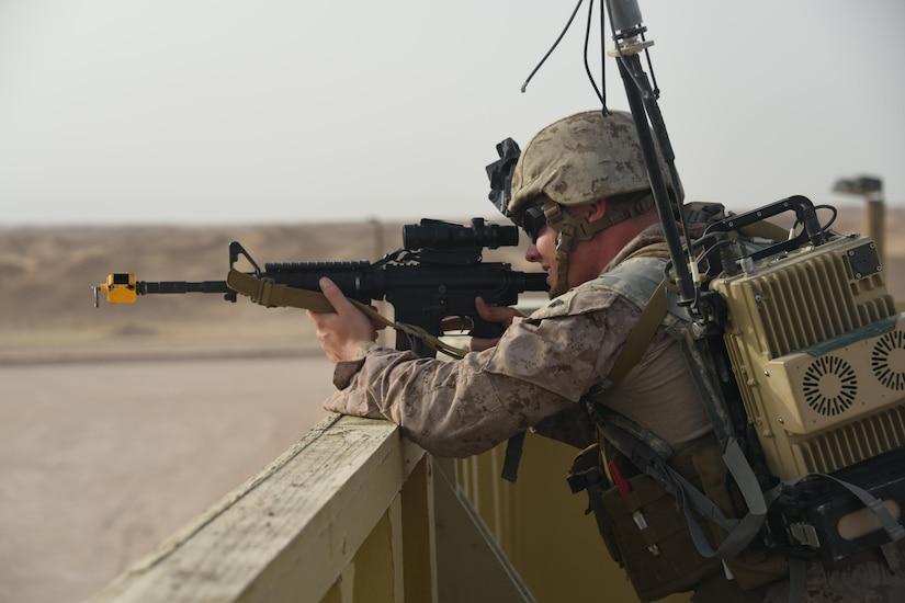 A Marine explosive ordnance disposal technician, with Special Purpose Marine Air Ground Task Force 17.2, Logistics Combat Element, Combat Logistics Detachment 1 EOD, provides overwatch for advancing EOD teams during a joint service EOD field training exercise at an undisclosed location in Southwest Asia, May 25, 2017. EOD teams from each of the four service branches, deployed to five different countries across the AOR, gathered for joint service EOD training, which allowed for the exchange of tactics, techniques and procedures between service branches. (U.S. Air Force photo/Tech. Sgt. Jonathan Hehnly)