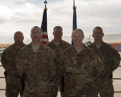 (From left to right) Master Sgt. Aaron Lesher, 455th Expeditionary Logistics Readiness Squadron, Master Sgt. Troy Dubois, 455th Expeditionary Security Forces Squadron, Master Sgt. James Pruitt, 455th Expeditionary Medical Group, Lisa Hietpas, 455th Expeditionary Operations Group, and Senior Master Sgt. Michael Martin, 455th Expeditionary Maintenance Squadron, are all first sergeants from Barksdale Air Force Base, La., who deployed to Bagram Airfield, Afghanistan, at the same time. (U.S. Air Force photo by Staff Sgt. Benjamin Gonsier)