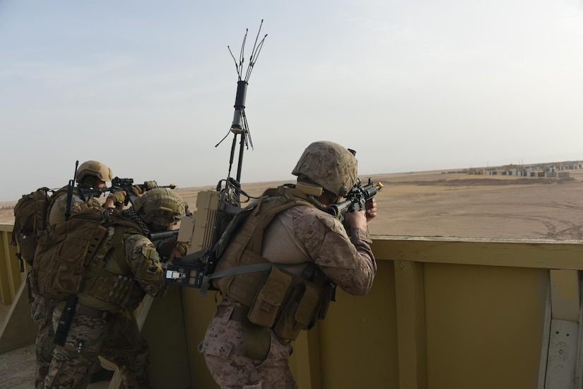 Air Force and Marine explosive ordnance disposal technicians work together to provide overwatch for advancing EOD teams during a joint service EOD field training exercise at an undisclosed location in Southwest Asia, May 25, 2017. EOD teams from each of the four service branches, deployed to five different countries across the AOR, gathered for joint service EOD training, which allowed for the exchange of tactics, techniques and procedures between service branches. (U.S. Air Force photo/Tech. Sgt. Jonathan Hehnly)