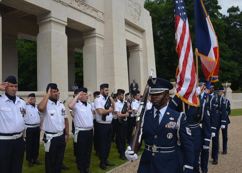 Airmen of the 52nd Fighter Wing Honor Guard march past French troops as part of a Memorial Day ceremony at the Lafayette Escadrille Memorial, Marnes-la-Coquette, France, May 28, 2017. This Memorial Day is especially signifcant because 2017 marks the centennial of United States' entry into the First World War. (U.S. Air Force photo by Capt. Ben Sowers/ Released)