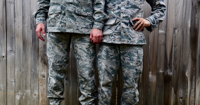 U.S. Air Force Staff Sgts. Alexx and Chip Pons, who serve separate commands as photojournalists at Joint Base San Antonio, Randolph, Texas, stand united as a married, dual-military, same sex couple. Since the repeal of Don't Ask, Don't Tell in 2011 and the legalization of same-sex marriage in 2015, the two have been able to serve openly with the support of their Air Force family. (U.S. Air Force photo by Staff Sgt. Alexx Pons)