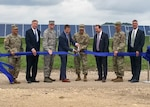 Defense Logistics Agency Energy Commander Air Force Brig. Gen. Martin Chapin (third from left] and other stakeholders participate in a ribbon-cutting ceremony with other senior officials for the large-scale renewable energy solar project at Fort Hood, Texas, June 2.