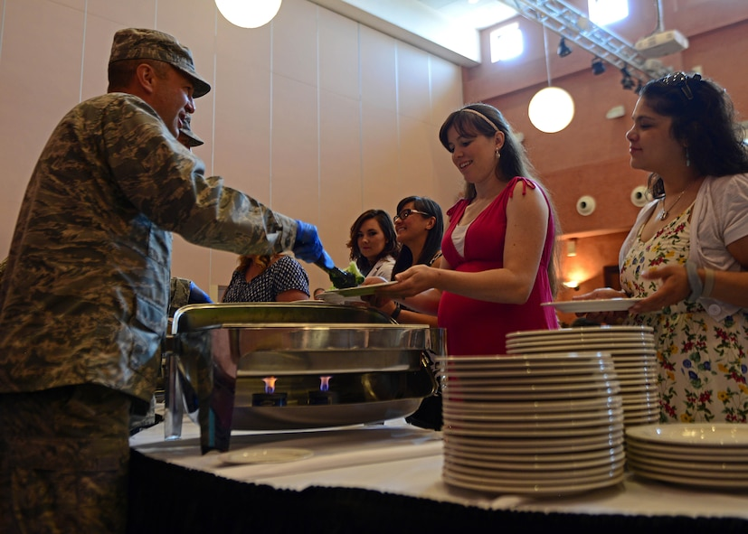 Col. Matthew Kmon, 31st Maintenance Group Commander, serves lunch to spouses during a spouse appreciation lunch, at Aviano Air Base, Italy, June 1, 2017. The Airman and Family Readiness Center coordinated the lunch to recognize spouses for their sacrifices. (U.S. Air Force photo by Airman 1st Class Ryan Brooks)