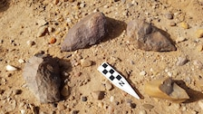 Acheulean tools, dating as far back as 1.76 million years ago in Africa and portions of the Asian continent recently discovered by USACE and USAFCEC archeologists. The two axes at the top of the photo are in their original location.