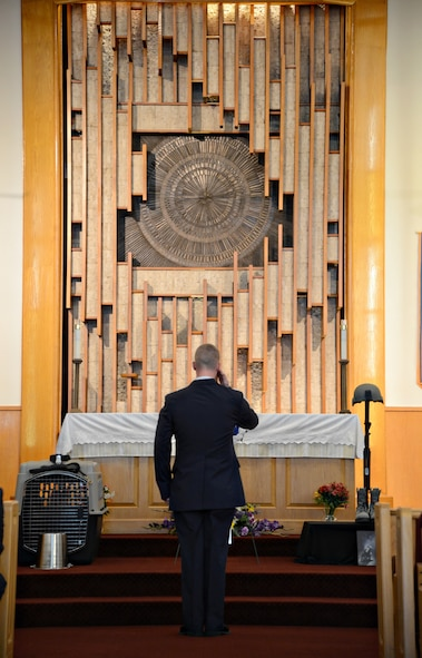 Members of the 72nd Security Forces Squadron's Charlie Flight, including Airman 1st Class Ryan Walsh, pictured, read the names of 143 law enforcement officers, Airmen and Military Working Dogs killed in action in 2016 during the National Police Week's memorial service at the Tinker Chapel May 15. (Air Force photo by Kelly White)
