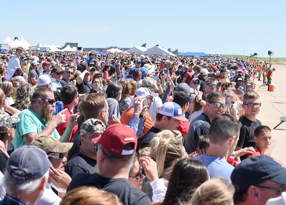 A record setting crowd of over 100,000 gathered to watch the U.S. Air Force Thunderbirds May 20 during the Star Spangled Salute Air Show at Tinker Air Force Base, Okla. There were more than 60,000 in attendance May 21. For the first time in Tinker air show history, officials closed the incoming gates to visitors after reaching parking capacity. The year 2017 marks the 75th anniversary of Tinker AFB, the 45th anniversary of the 507th Air Refueling Wing and the 40th anniversary of the E-3 Sentry at Tinker AFB.  (Air Force photo by Mark Hybers)