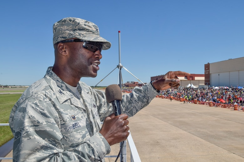 Col. Kenyon Bell, 72nd Air Base commander, emphasizes the importance of community support to the base while giving opening remarks during Tinker Air Force Base's Star Spangled Salute air show May 21, 2017, Tinker Air Force Base, Oklahoma. Col. Bell addressed the record-breaking crowd from the raised announcers booth at air show center. (U.S. Air Force photo/Greg L. Davis)
