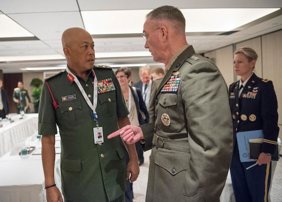 Marine Corps Gen. Joe Dunford, right, chairman of the Joint Chiefs of Staff, meets with Malaysian Chief of Defense Gen. Raja Mohamed Affandi Raja Mohamed Noor during a bilateral session at the Shangri-La Dialogue security conference in Singapore, June 4, 2017.