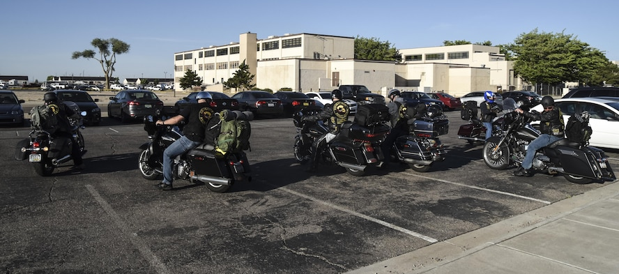 Members of the Combat Veterans Motorcycle Association park their bikes in front of the Thunderbird Inn dining facility on Kirtland Air Force Base, May 30, 2017. The veterans spoke with Team Kirtland airmen about suicide prevention and having each other's backs in all situations. (U.S. Air Force Photo/Senior Airman Chandler Baker)