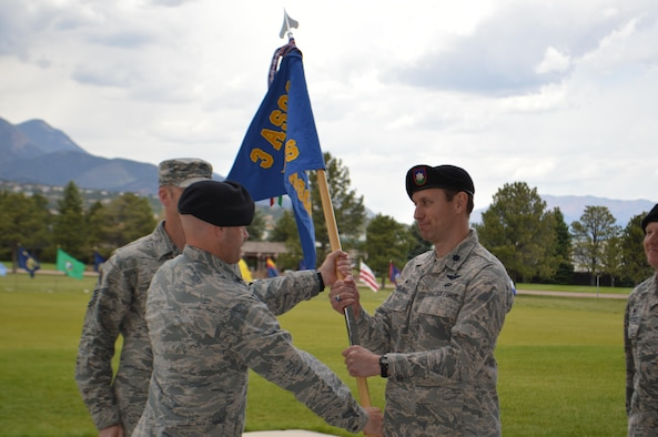 Lt. Col. Jeffrey P. Strange accepts the 13th Air Support Operations Squadron guidon from Col. Aaron Ullman, commander, 3rd Air Support Operations Group, Fort Hood, Texas, during a change of command ceremony at Founders Field, May 30, 2017, Fort Carson, Colo.  Strange assumes command the squadron after Lt. Col. John W. Blocher relinquished it. (U.S. Army photo by Dani Johnson)