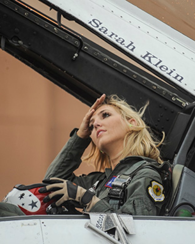Miss Oklahoma 2016, Sarah Klein, adjusts her hair after doffing her helmet before getting out of the  in the backseat of a Thunderbirds F-16D May 18, 2017, Tinker Air Force Base, Oklahoma. Klein was flown by Lt Col. Kevin Walsh, Thunderbirds operations officer, during an orientation flight in which she pulled 9.2 Gs. (U.S. Air Force photo/Greg L. Davis)