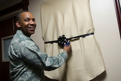 Maj. Gen. Roosevelt Allen Jr. cuts the ribbon for an unveiling of his portrait as former 79th Medical Wing Commander on Joint Base Andrews June 2, 2017. (Photo by Senior Master Sgt. Adrian Cadiz)(Released)