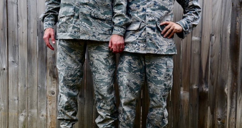 Staff Sgts. Alexx and Chip Pons, who serve separate commands as photojournalists at Joint Base San Antonio-Randolph, Texas, stand united as a married, dual-military, same sex couple. Since the repeal of Don't Ask, Don't Tell in 2011 and the legalization of same-sex marriage in 2015, the two have been able to serve openly with the support of their Air Force family. (U.S. Air Force photo/Staff Sgt. Alexx Pons)