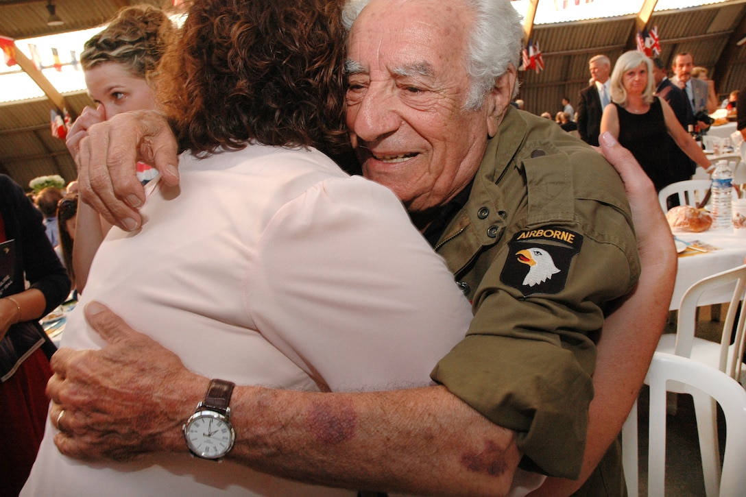 World War II veteran Vince Speranza receives a hug as an appreciation for his service