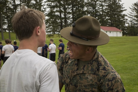 Drill Instructor Sgt. Kelvin Gonzalez, Support Battalion, MCRD San Diego, encourages a Poolee at the RS Portland Annual Pool Function. Poolees within RS Portland gathered at Camp Rilea, Warrenton, Oregon, for an annual 3-day field meet. Poolees were given an opportunity to experience aspects of recruit training to include drill instructors, and physical training. (U.S. Marine Corps Photo by Sgt. Taylor Morton/Released)