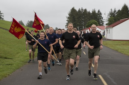 Commanding Officer, Maj. Brooks Boehlert and Sergeant Major, Sgt. Maj. Mark Wright lead the motivational run at the RS Portland Annual Pool Function. Poolees within RS Portland gathered at Camp Rilea, Warrenton, Oregon, for an annual 3-day field meet. Poolees were given an opportunity to experience aspects of recruit training to include drill instructors, and physical training. (U.S. Marine Corps Photo by Sgt. Taylor Morton/Released)