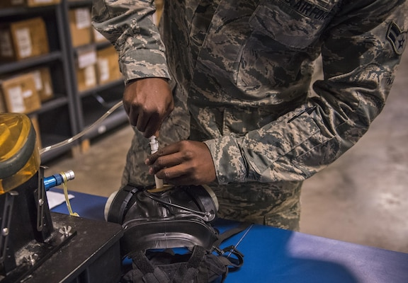 Gas mask fit testing is performed by the 96th Logistics Readiness Squadron's individual protective equipment section.  (U.S. Air Force photo/Ilka Cole)
