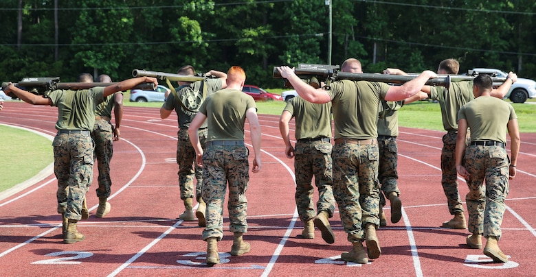 Marines prepare for the stinger missile race during a combine hosted by Marine Air Control Group 28 at Marine Corps Air Station Cherry Point, N.C., June 2, 2017. During the race, two people from each team ran with a stinger missile for one mile. While running, the Marines were able to pass the missile back and forth to their partner. Each squadron within MACG-28 had teams of 20 Marines competing in multiple events including a relay race, javelin throw, and Humvee push. (U.S. Marine Corps photo by Lance Cpl. Cody Lemons/Released)