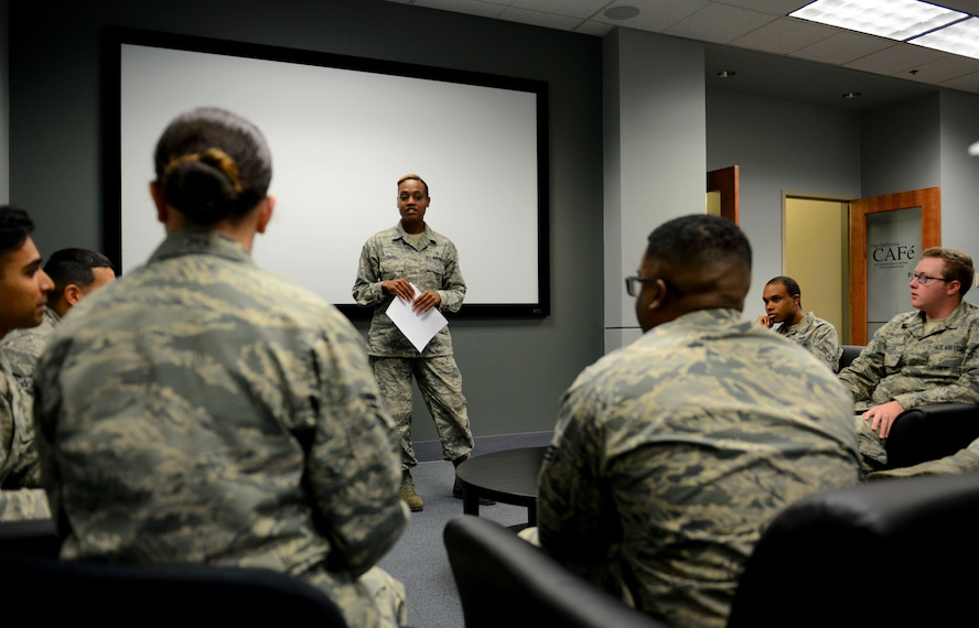 """Senior Airman Ashley Davis, 9th Aerospace Medicine Squadron bioenvironmental technician speaks at a meeting for the organization A.C.E or """"Airman Committed to Excellence"""" at Beale AFB, California May 31, 2017. The purpose of ACE is to bring together Airmen from across the base to network both professionally and socially with the goal of building better bonds as Wingmen. (U.S. Air Force photo/Staff Sgt. Jeffrey Schultze)"""