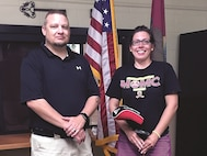 Brandon French, prevention coordinator, Army Substance Abuse Program, presents Somer Martin, the second-prize winner of the ASAP Scavenger Hunt, with one driver after she completed hunt, which occurred during the month of April.