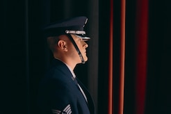 Staff Sgt. Scott Zawacki, U.S. Air Force Honor Guardsman, prepares to post the colors during an U.S. Air Force Band Airmen of Note performance at The Classic Center Theatre in Athens, Ga., May 24, 2017. Both the band and the honor guard share the same mission: to honor those who have served, inspire patriotism and service, and positively impact the global community on behalf of the U.S. Air Force and the United States of America. (U.S. Air Force photo by Senior Airman Delano Scott)